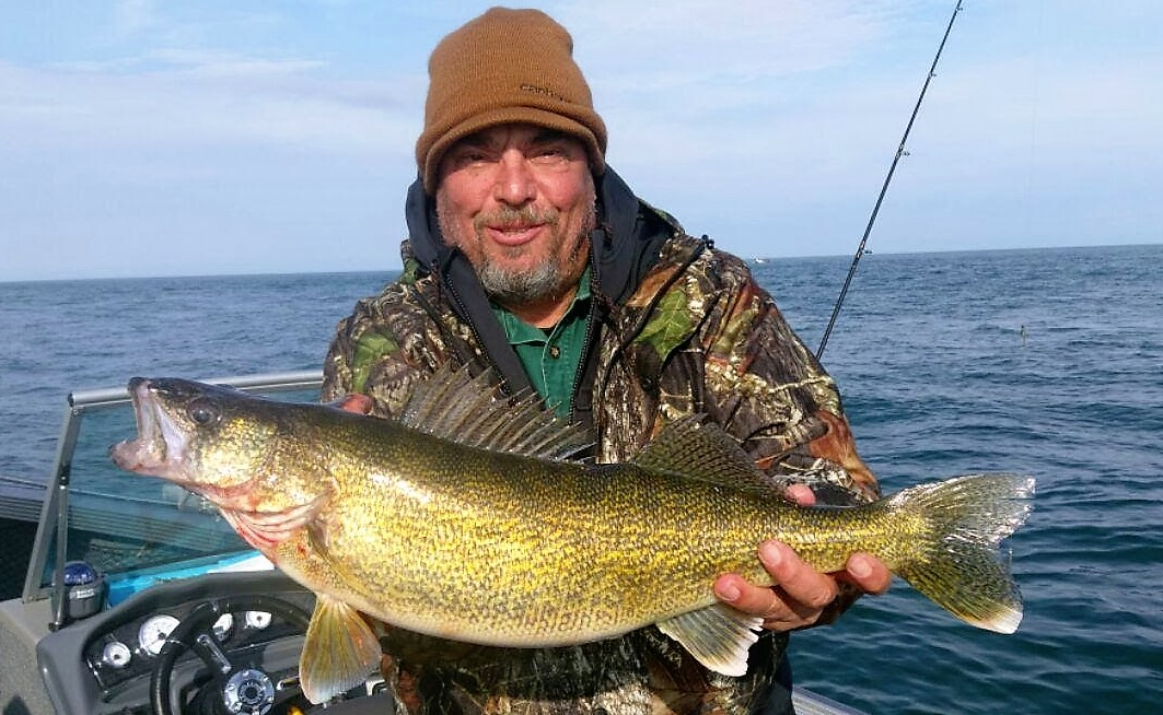 Joe Manhart of New Jersey with a Niagara Bar walleye caught while fishing with Wet Net Charters.