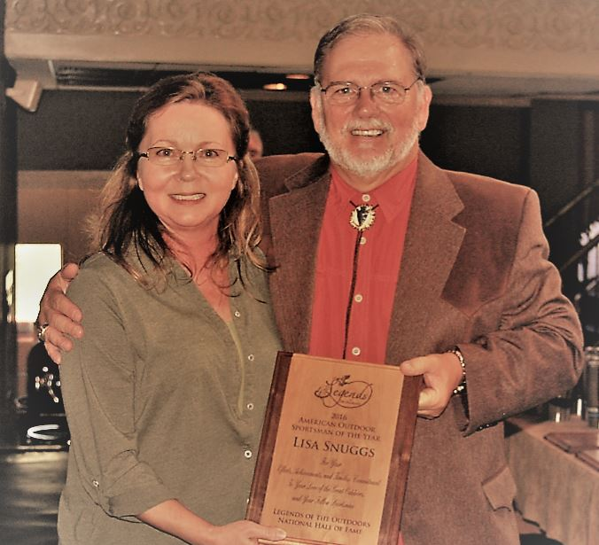 Lisa Snuggs accept her award from Legends of the Outdoors Hall of Fame founder, Garry Mason. Photo by Rob Simbeck