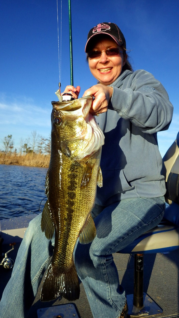 Lisa Snuggs with a wintertime bass caught in a small lake at Sumter Farms near Geiger, Ala., on the far western edge of the Alabama Black Belt Region. Photo by Jeff Samsel