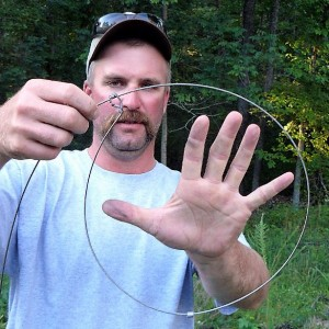 Thad Davis provides a visual example of the snare hoop diameter used most effectively with hogs.  Jill Easton Photo