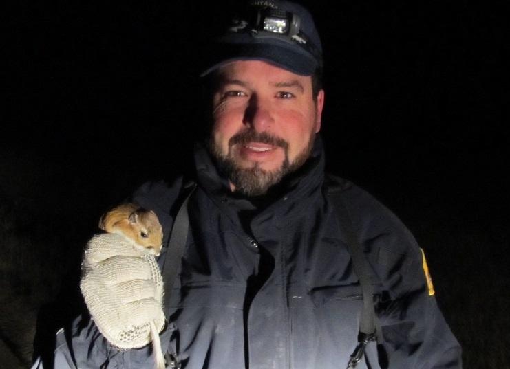 Mark Szczypinski holds a kangaroo rat, another critter that depends on healthy sagebrush habitat.