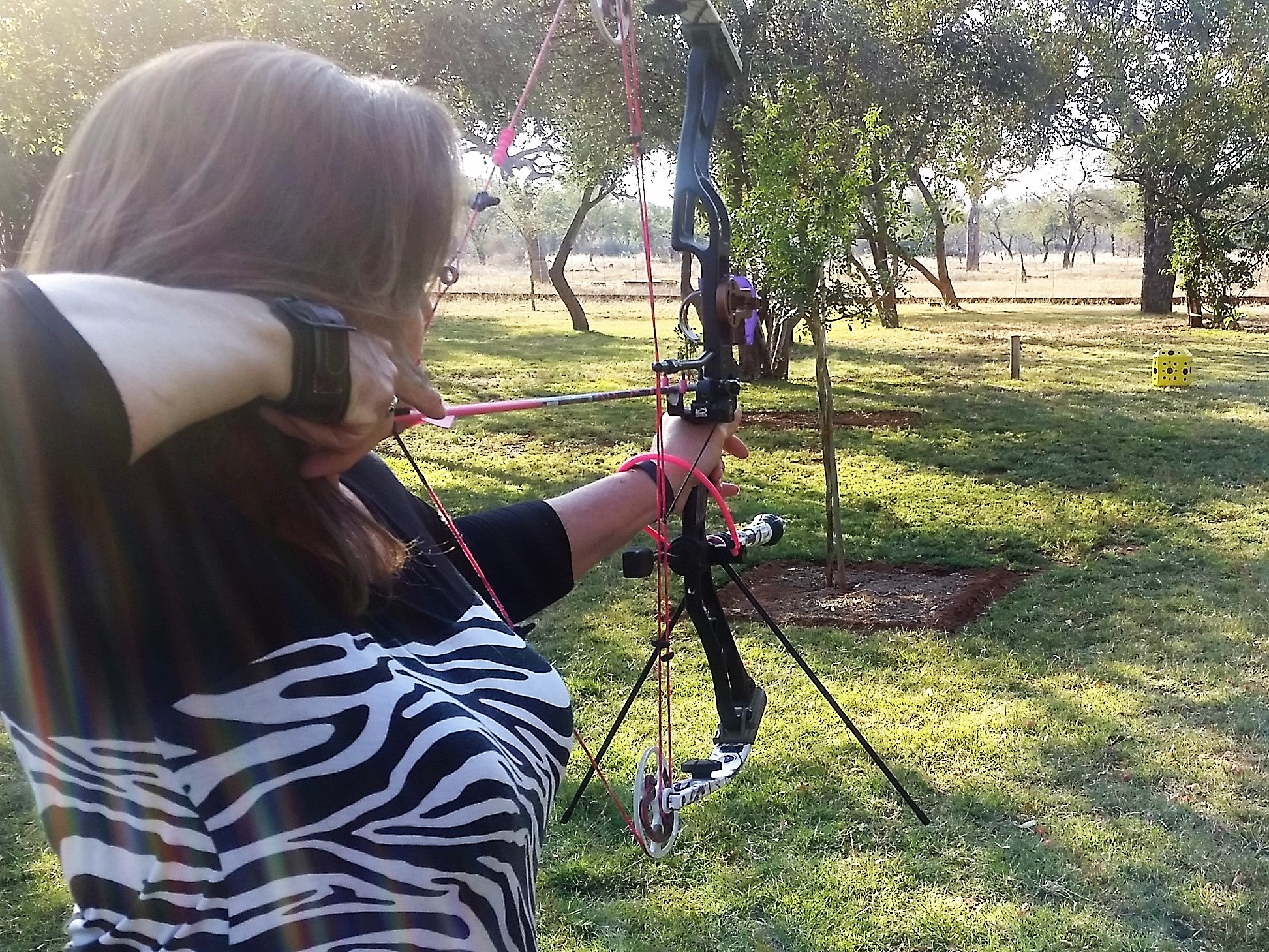 Anne O'Leary arrives in Thabazimbi Province in South Africa to unpack her Elite Archery bow to assure shot accuracy.